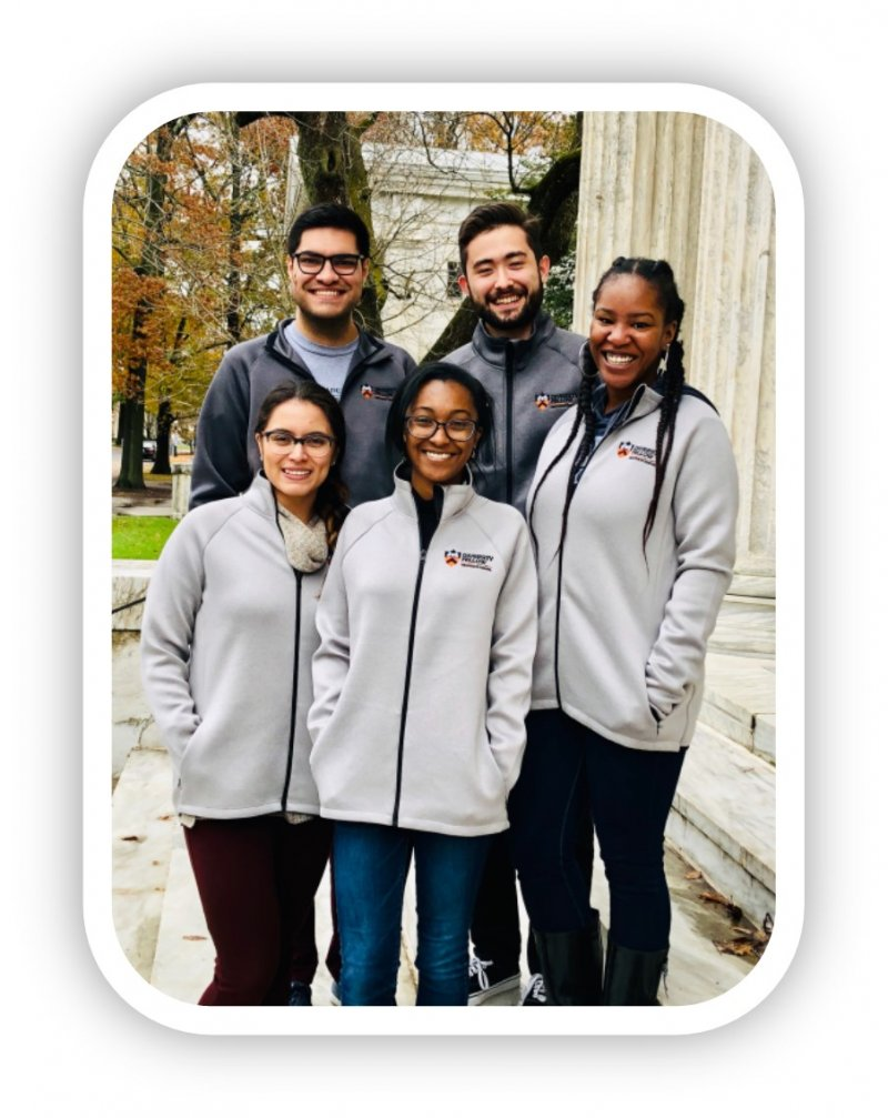 Diverse group of PhD students smiling wearing Princeton fleece